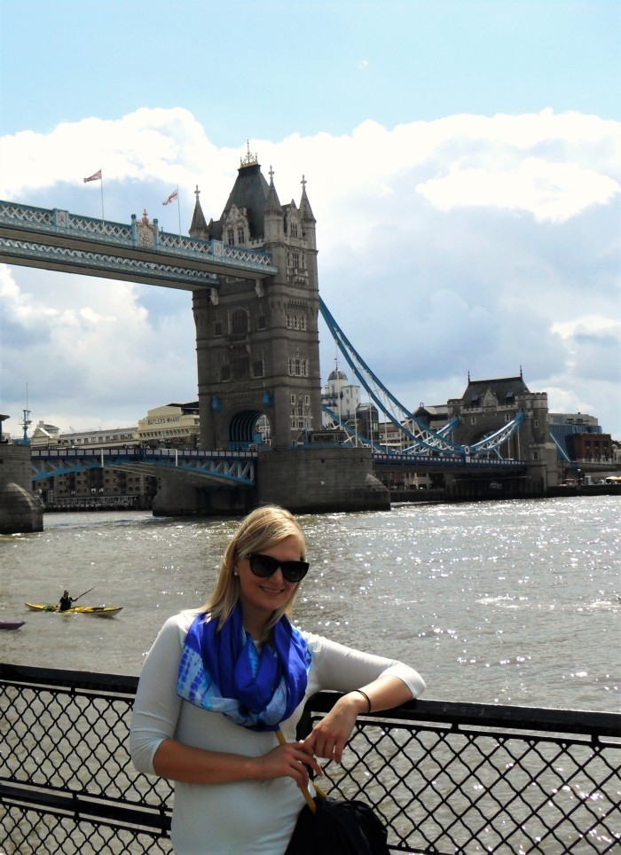 Posing for typical tourist photo in front of Tower Bridge.