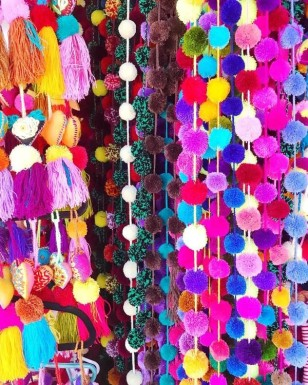 Pom pom tassels that you can hang in your home also purchased at these shops.